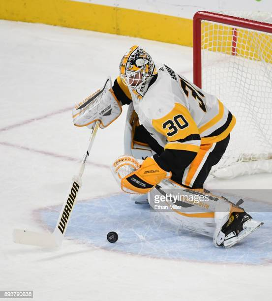 Matt Murray of the Pittsburgh Penguins makes a save against the Vegas Golden Knights in the second period of their game at TMobile Arena on December...