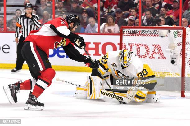 Matt Murray of the Pittsburgh Penguins makes a save against Zack Smith of the Ottawa Senators during the third period in Game Three of the Eastern...