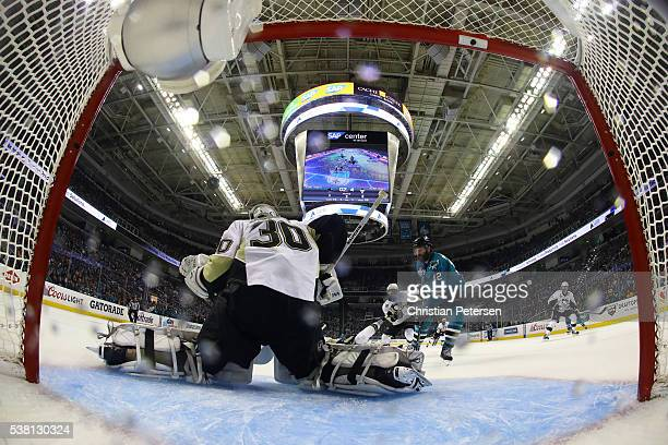 Matt Murray of the Pittsburgh Penguins makes a save in front of Patrick Marleau of the San Jose Sharks during the second period in Game Three of the...
