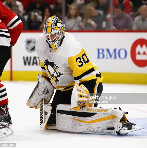 Matt Murray of the Pittsburgh Penguins makes a save off of his leg pad against the Chicago Blackhawks during the season opening game at the United...