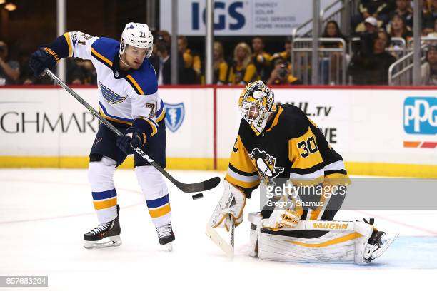 Matt Murray of the Pittsburgh Penguins makes a third period save on Vladimir Sobotka of the St Louis Blues at PPG PAINTS Arena on October 4 2017 in...
