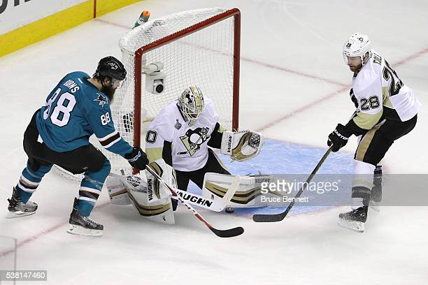 Matt Murray of the Pittsburgh Penguins makes the save on Brent Burns of the San Jose Sharks in Game Three of the 2016 NHL Stanley Cup Final at SAP...