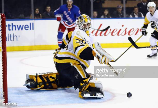 Matt Murray of the Pittsburgh Penguins makes the second period kick save against the New York Rangers at Madison Square Garden on October 17 2017 in...