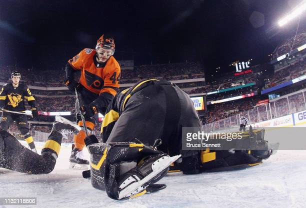 Matt Murray of the Pittsburgh Penguins makes the stop on Phil Varone of the Philadelphia Flyers during the 2019 Coors Light NHL Stadium Series game...