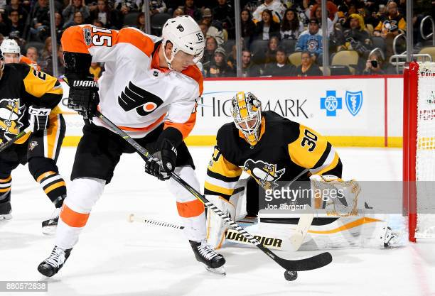 Matt Murray of the Pittsburgh Penguins protects the net against Jori Lehtera of the Philadelphia Flyers at PPG Paints Arena on November 27 2017 in...