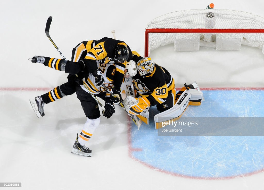 Matt Murray #30 of the Pittsburgh Penguins protects the net against Patrice Bergeron #37 of the Boston Bruins at PPG Paints Arena on January 7, 2018 in Pittsburgh, Pennsylvania.