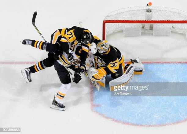 Matt Murray of the Pittsburgh Penguins protects the net against Patrice Bergeron of the Boston Bruins at PPG Paints Arena on January 7 2018 in...