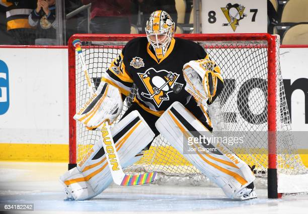 Matt Murray of the Pittsburgh Penguins protects the net with pride tape during warm ups prior to You Can Play Night at PPG Paints Arena on February 7...