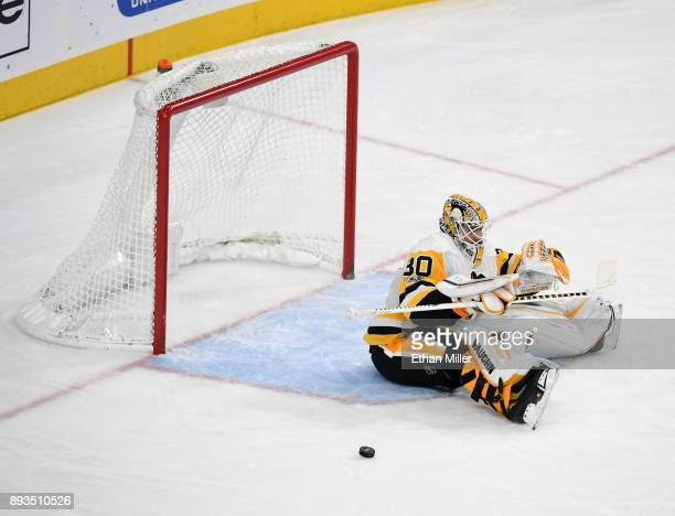Matt Murray of the Pittsburgh Penguins reacts after Jon Merrill of the Vegas Golden Knights scored a goal against him in the third period of their...