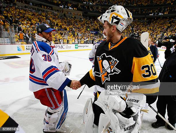 Matt Murray of the Pittsburgh Penguins shakes hands with Henrik Lundqvist of the New York Rangers after a 63 win to clinch the series in Game Five of...