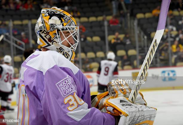 Matt Murray of the Pittsburgh Penguins skates during warmups while wearing a Hockey Fights Cancer jersey at PPG Paints Arena on November 7 2017 in...