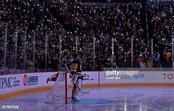 Matt Murray of the Pittsburgh Penguins stands in the crease during a moment of silence for Hockey Fights Cancer before the the first period during...