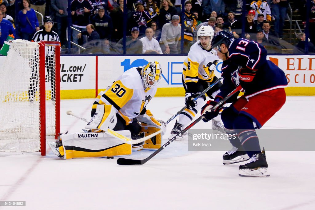 Matt Murray #30 of the Pittsburgh Penguins stops a shot by Cam Atkinson #13 of the Columbus Blue Jackets during overtime on April 5, 2018 at Nationwide Arena in Columbus, Ohio. Pittsburgh defeated Columbus 5-4 in overtime.