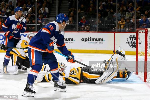 Matt Murray of the Pittsburgh Penguins stops a shot from Anthony Beauvillier of the New York Islanders during the third period at Barclays Center on...