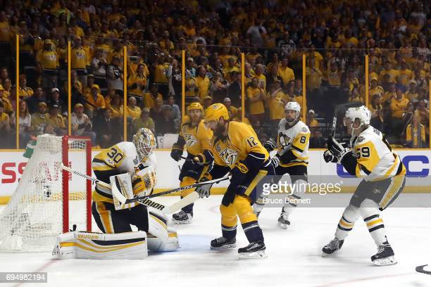Matt Murray of the Pittsburgh Penguins stops a shot under pressure from Mike Fisher of the Nashville Predators during the first period in Game Six of...