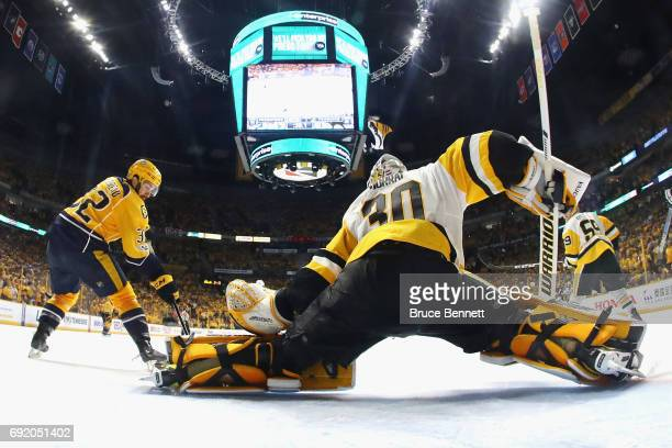 Matt Murray of the Pittsburgh Penguins tends goal against Frederick Gaudreau of the Nashville Predators during the third period in Game Three of the...