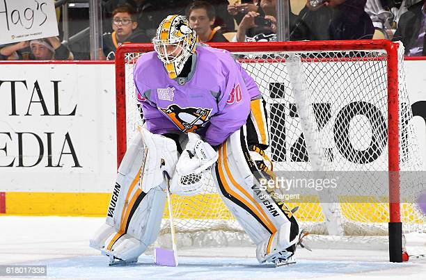 Matt Murray of the Pittsburgh Penguins warms up while wearing a purple Hockey Fights Cancer jersey prior to the game against the Florida Panthers at...