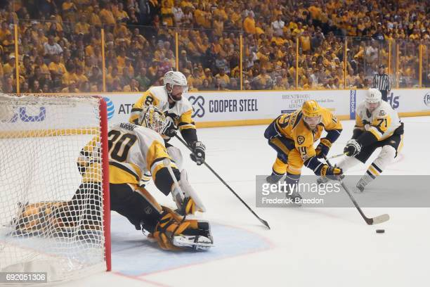 Matt Murray tends to net as teammate Evgeni Malkin of the Pittsburgh Penguins defends Calle Jarnkrok of the Nashville Predators in Game Three of the...