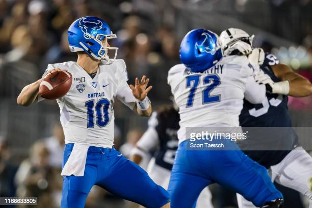 Matt Myers of the Buffalo Bulls attempts a pass against the Penn State Nittany Lions during the first half at Beaver Stadium on September 07 2019 in...