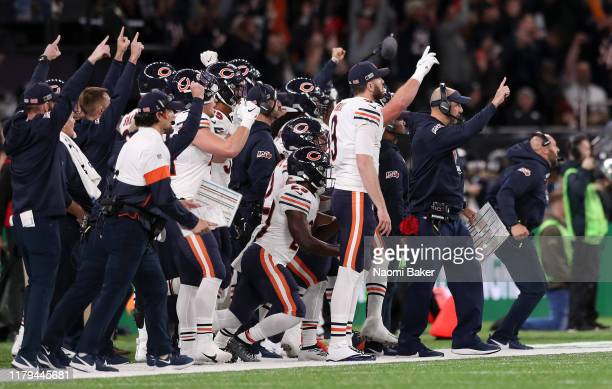Matt Nagy, Head Coach of Chicago Bears celebrates with his team on the sideline during the game between Chicago Bears and Oakland Raiders at...