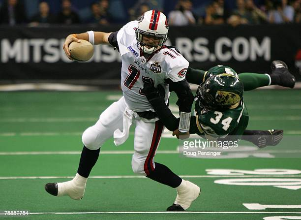 Matt Nagy of the Columbus Destroyers is sacked by Steve Watson of the San Jose SaberCats during ArenaBowl XXI at New Orleans Arena on July 29 2007 in...