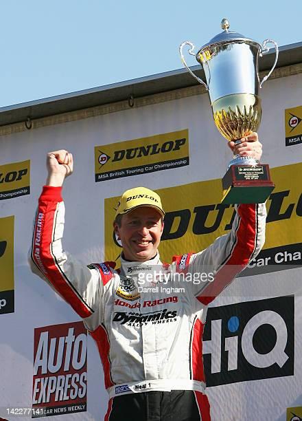 Matt Neal of Great Britain driver of the Honda YUASA Racing Team Honda Civic celebrates winning the Dunlop MSA British Touring Car Championship race...