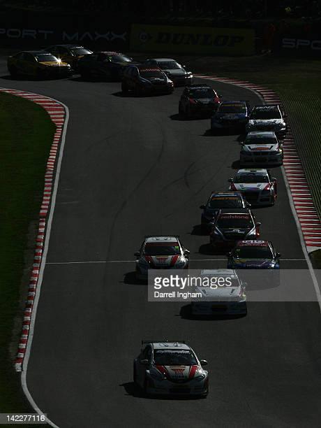 Matt Neal of Great Britain driving the Honda YUASA Racing Team Honda Civic leads the field during the Dunlop MSA British Touring Car Championship...