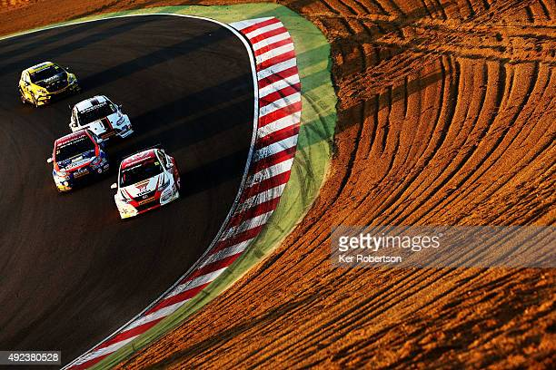 Matt Neal of Honda Racing heads a pack of cars down Paddock Hill during Race Three of the Final Round of the Dunlop MSA British Touring Car...