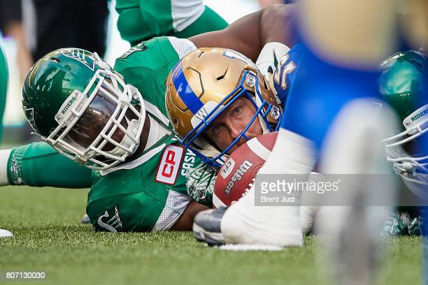 Matt Nichols of the Winnipeg Blue Bombers looks to see if he reached the first down marker after scrambling in the game between the Winnipeg Blue...