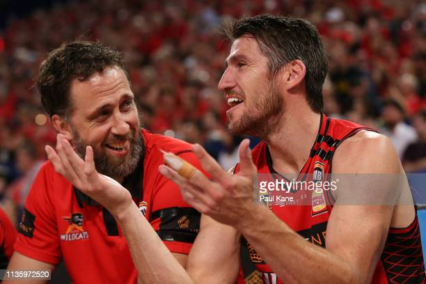 Matt Nielsen assistant coach of the Wildcats and Damian Martin share a moment late in the 4th quarter during game three of the NBL Grand Final Series...