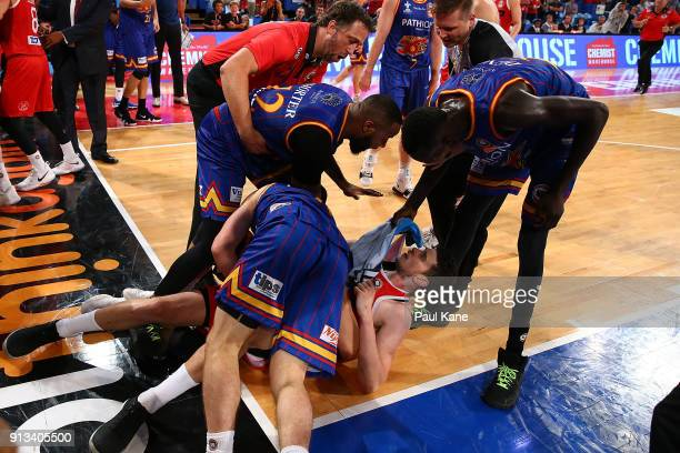 Matt Nielsen assistant coach of the Wildcats steps in as Shannon Shorter Majok Deng and Nelson Larkins of the 36ers wrestle with Clint Steindl of the...