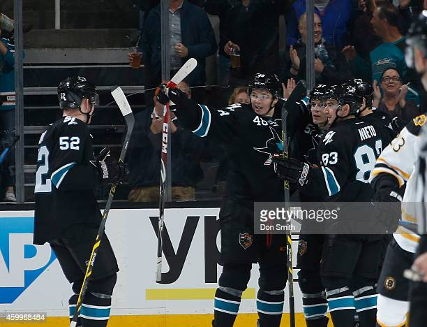 Matt Nieto, Matt Irwin and Tomas Hertl of the San Jose Sharks celebrate a goal against the Boston Bruins during an NHL game on December 4, 2014 at...