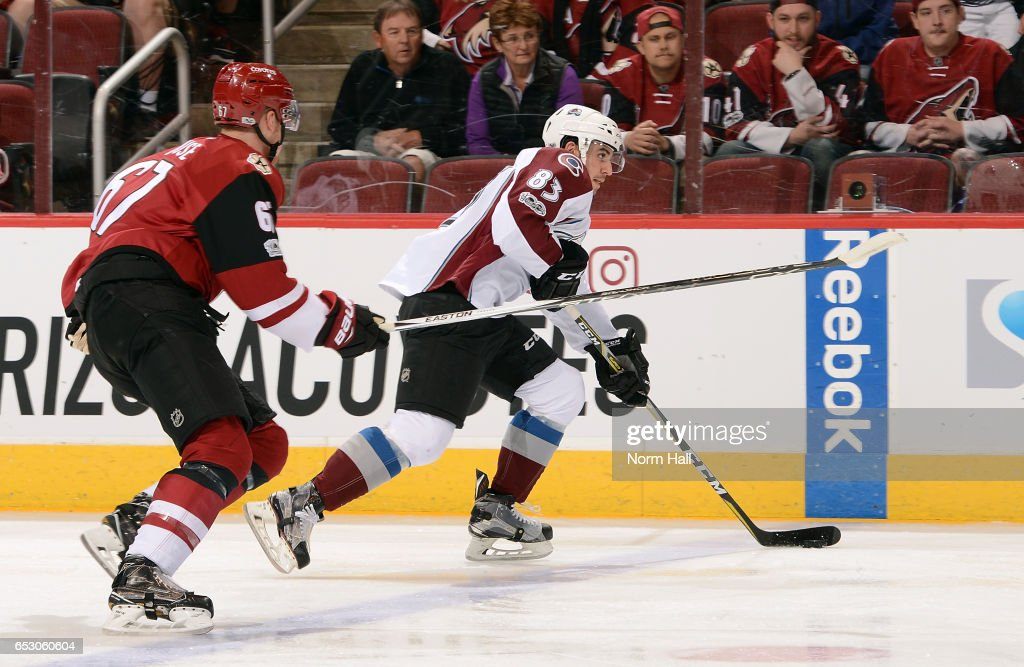 Matt Nieto #83 of the Colorado Avalanche advances the puck up ice ahead of Lawson Crouse #67 of the Arizona Coyotes during the first period at Gila River Arena on March 13, 2017 in Glendale, Arizona.