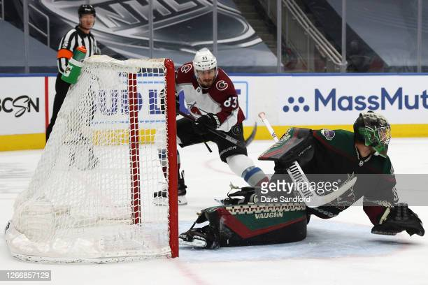 Matt Nieto of the Colorado Avalanche scores against goaltender Darcy Kuemper of the Arizona Coyotes in the first period of Game Four of the Western...