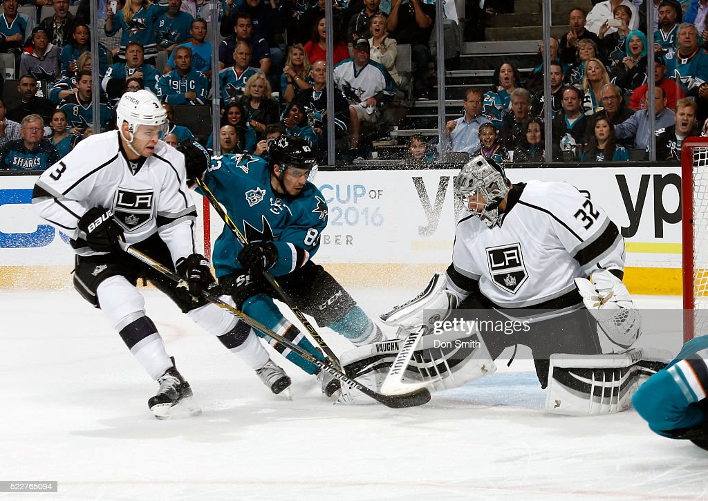 Matt Nieto #83 of the San Jose Sharks attempts to chip the puck past Jonathan Quick #32 of the Los Angeles Kings as Brayden McNabb #3 of the Los Angeles Kings defends against the shot during the Western Conference First Round during the 2016 NHL Stanley Cup Playoffs at the SAP Center at San Jose on April 20, 2016 in San Jose, California.