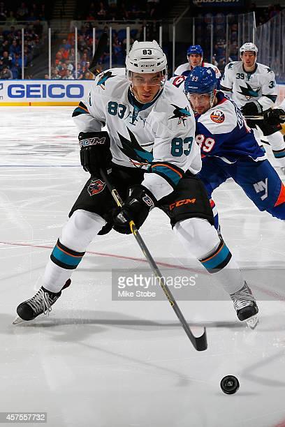 Matt Nieto of the San Jose Sharks skates against the New York Islanders at Nassau Veterans Memorial Coliseum on October 16, 2014 in Uniondale, New...