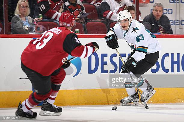 Matt Nieto of the San Jose Sharks skates with the puck during the NHL game against the Arizona Coyotes at Gila River Arena on November 19 2016 in...