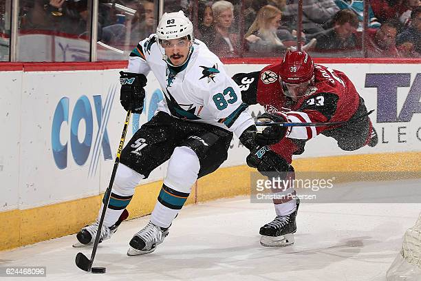 Matt Nieto of the San Jose Sharks skates with the puck past Alex Goligoski of the Arizona Coyotes during the second period of the NHL game at Gila...
