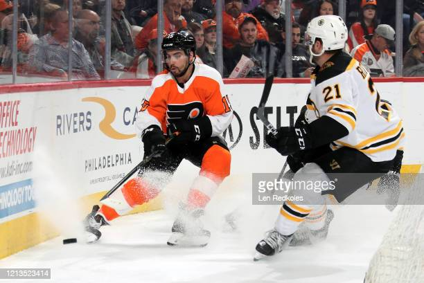 Matt Niskanen of the Philadelphia Flyers passes the puck against Nick Ritchie of the Boston Bruins on March 10 2020 at the Wells Fargo Center in...