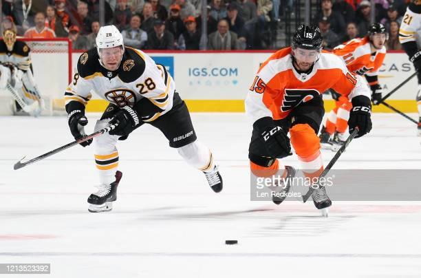 Matt Niskanen of the Philadelphia Flyers skates the puck against Ondrej Kase of the Boston Bruins on March 10 2020 at the Wells Fargo Center in...
