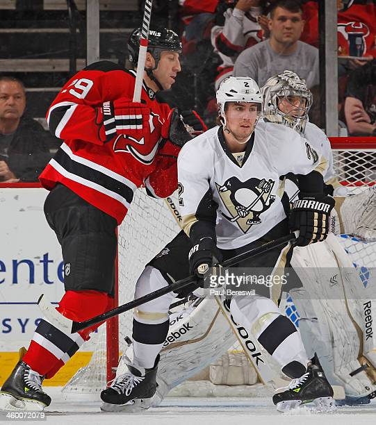Matt Niskanen of the Pittsburgh Penguins defends against Ryane Clowe of the New Jersey Devils in an NHL hockey game at Prudential Center on December...