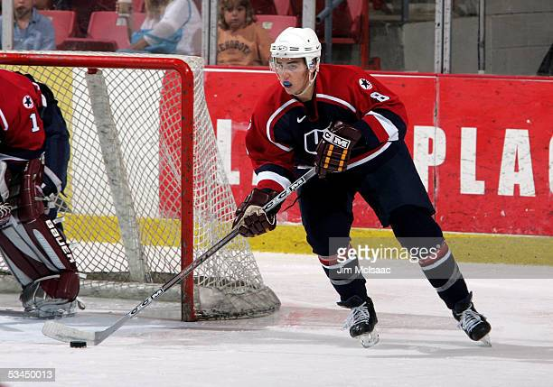 Matt Niskanen of the United States carries the puck up ice against Finland during USA Hockey's Junior Men's Summer Challenge on August 12, 2005 at...