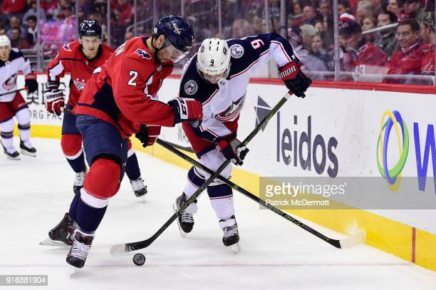 Matt Niskanen of the Washington Capitals and Artemi Panarin of the Columbus Blue Jackets battle for the puck in the second period at Capital One...