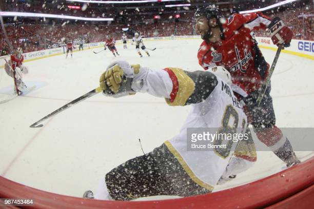 Matt Niskanen of the Washington Capitals and Jonathan Marchessault of the Vegas Golden Knights battle along the boards during the second period in...