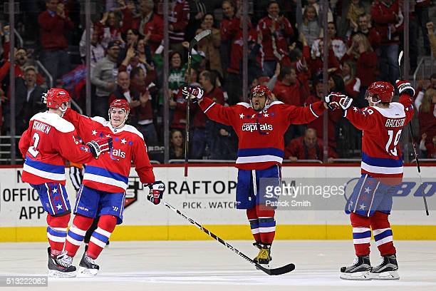 Matt Niskanen of the Washington Capitals celebrates his goal with teammates TJ Oshie Alex Ovechkin and Nicklas Backstrom against the Pittsburgh...