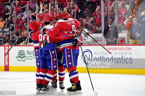 Matt Niskanen of the Washington Capitals celebrates his third period goal with his teammates during their game against the Pittsburgh Penguins at...