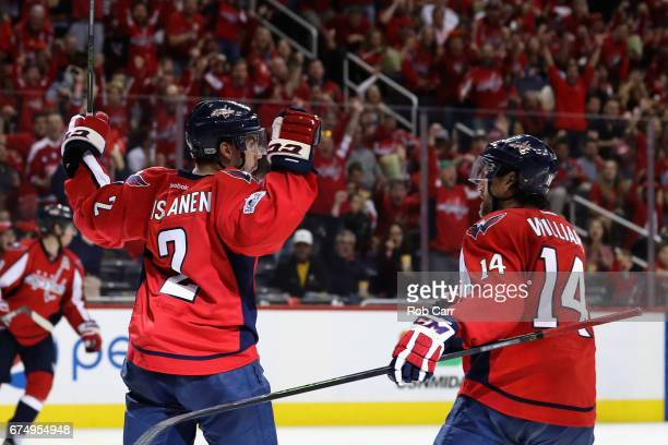 Matt Niskanen of the Washington Capitals celebrates scoring a second period goal with Justin Williams against the Pittsburgh Penguins in Game Two of...