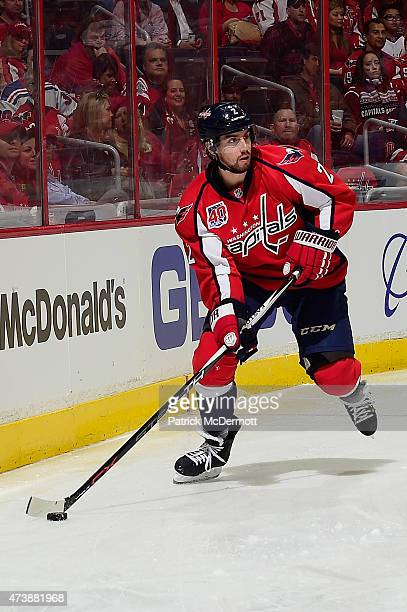 Matt Niskanen of the Washington Capitals controls the puck against the New York Rangers during the first period in Game Three of the Eastern...