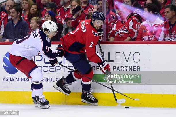 Matt Niskanen of the Washington Capitals controls the puck against Artemi Panarin of the Columbus Blue Jackets in the second period in Game Five of...