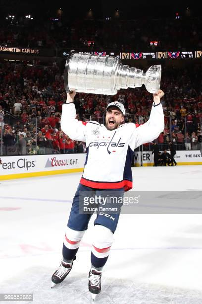 Matt Niskanen of the Washington Capitals hoists the Stanley Cup after his team defeated the Vegas Golden Knights 43 in Game Five of the 2018 NHL...
